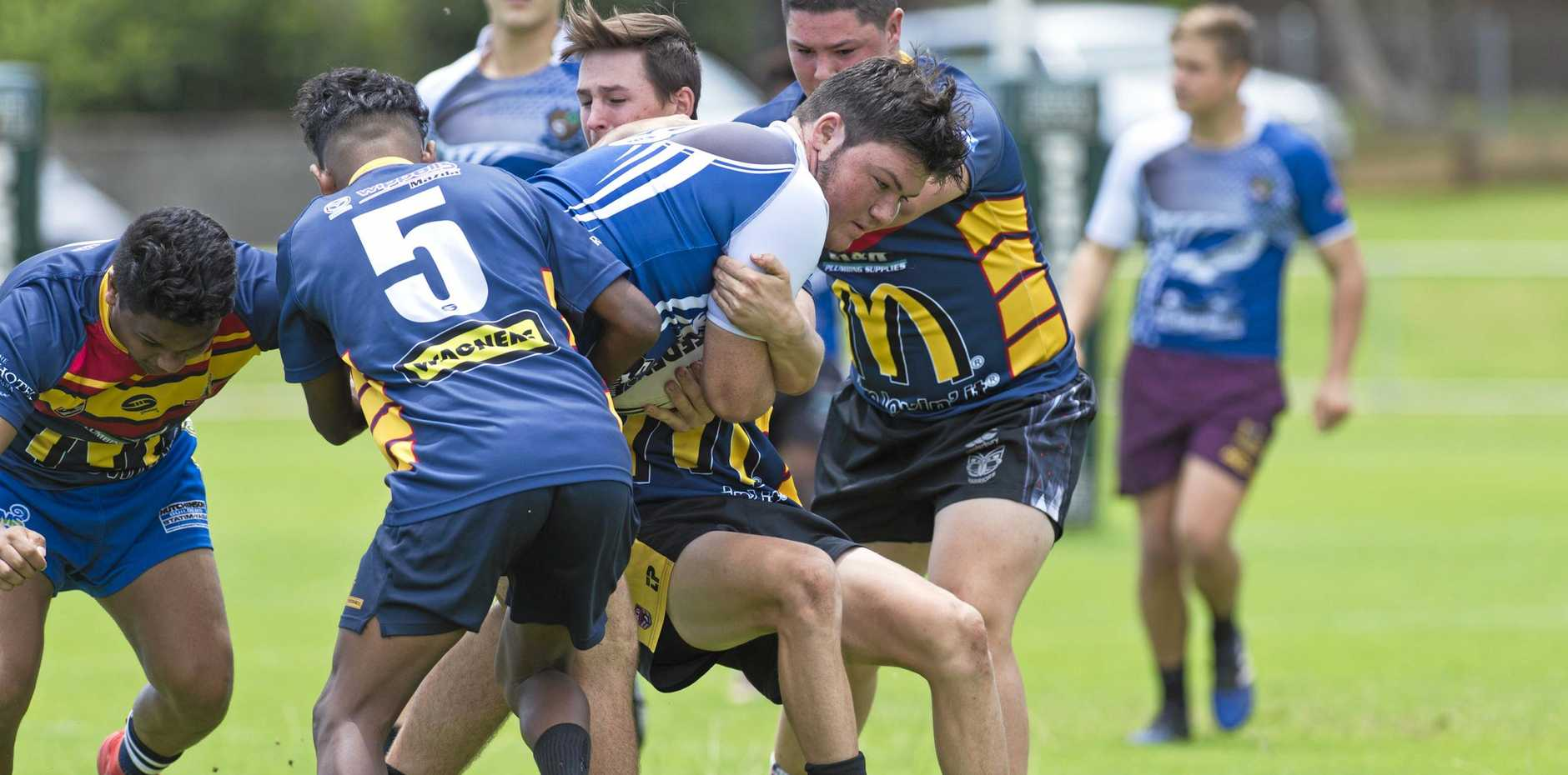 Conan Holding takes on the defence during Western Mustangs open trials which saw players vying for spots in the U18 and U20 state squads to compete next year.