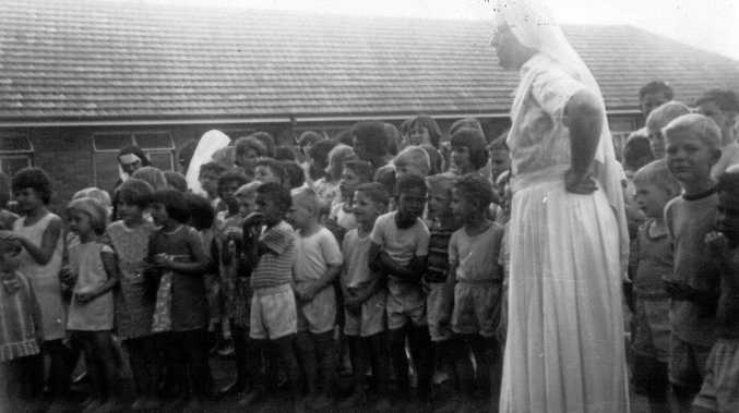 File photo of children and a nun at the Neerkol Orphanage, near Rockhampton, which was investigated under the Royal Commission into Child Sexual Abuse.