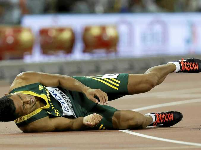 South Africa's Wayde Van Niekerk takes a tumble during competition.