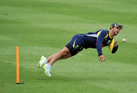 Australian wicketkeeper Matthew Wade puts in a big effort at training.