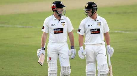 Western Australian batsmen Shaun Marsh (left) and Hilton Cartwright leave the field during the Shield match against Tasmania.