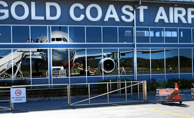 Two people are being treated for burns at Gold Coast Airport.