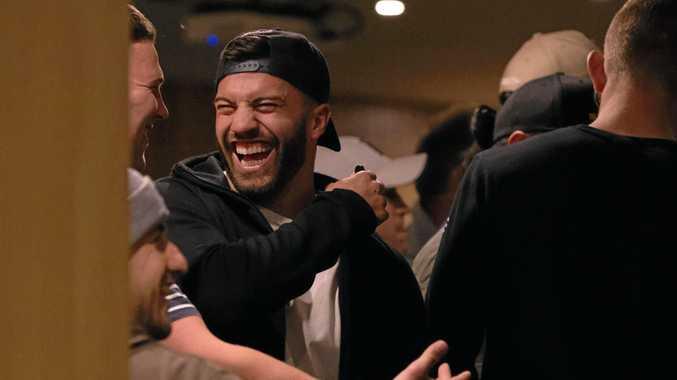 James Tedesco shares a laugh with his teammates.