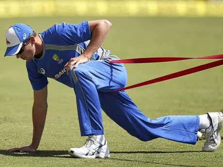 Josh Hazlewood stretches at training and is ahead of schedule in his recovery from a side strain.