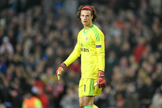 Mile Svilar of Benfica looks dejected following his own goal in the defeat to Manchester United.
