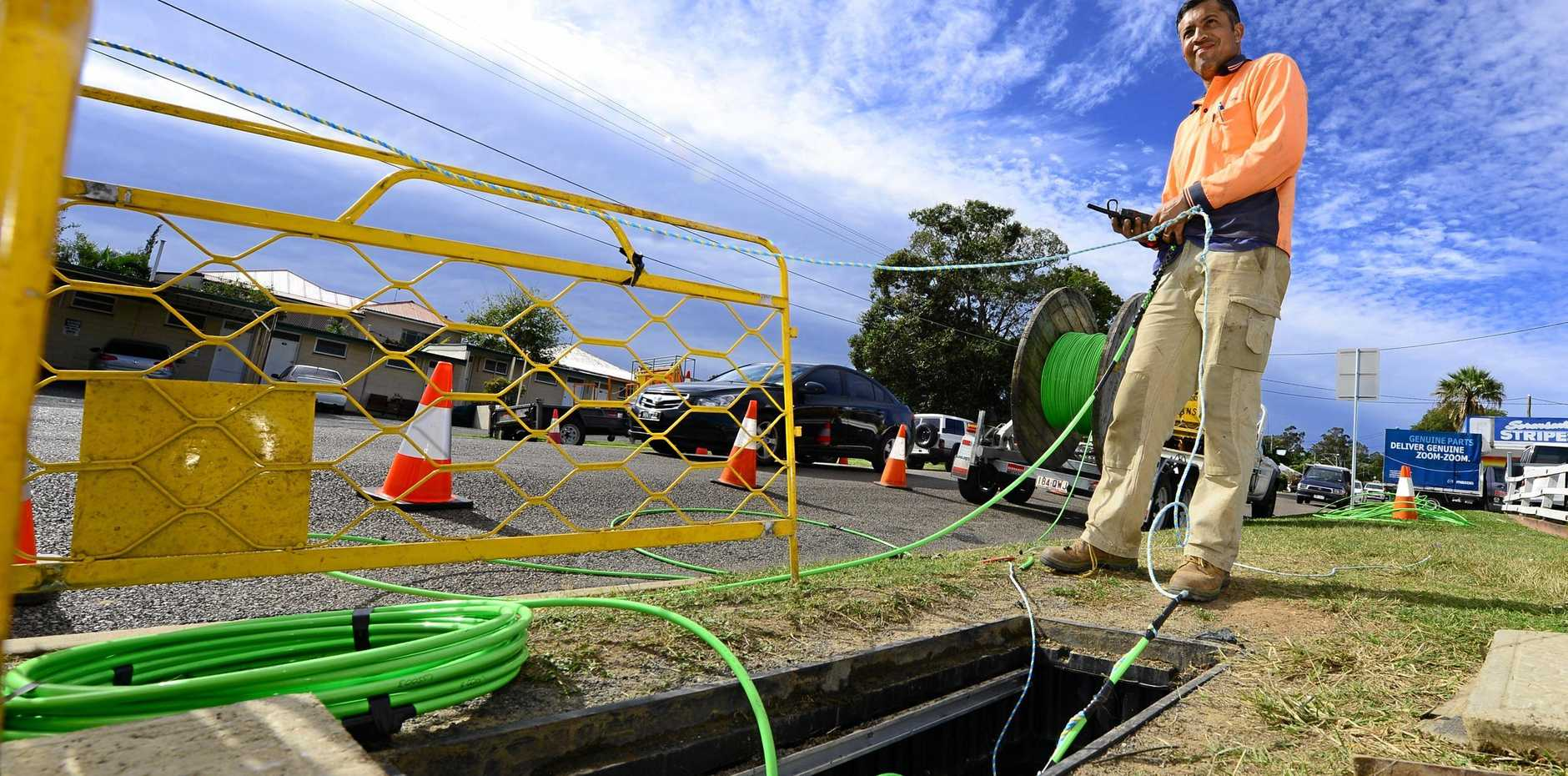 WHERE'S THE NET: A worker laying down fibre optic cable as part of the NBN rollout.