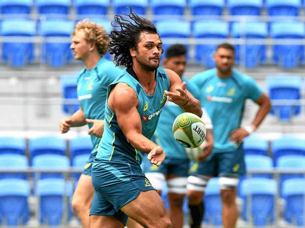 Karmichael Hunt passes the ball during a training session as the Wallabies prepare to take on Japan.