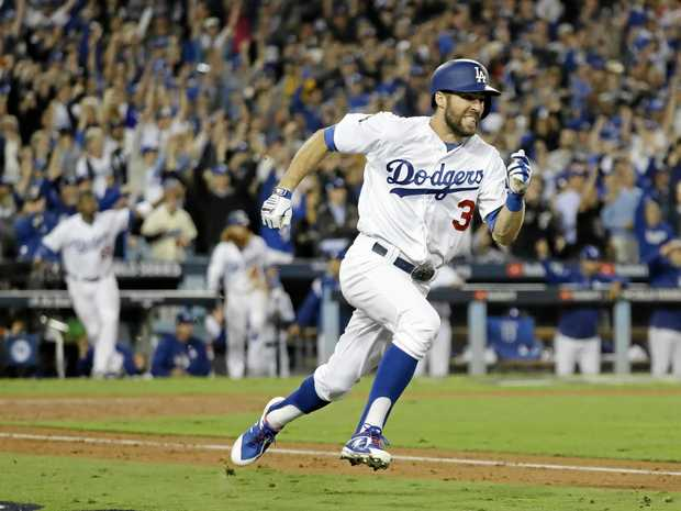 Chris Taylor sets off after scoring a hit against the Houston Astros during Game 6 of baseball's World Series.