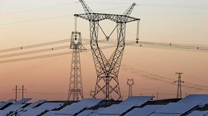 Solar panels are seen near a power grid. (AP Photo/Ng Han Guan, File)