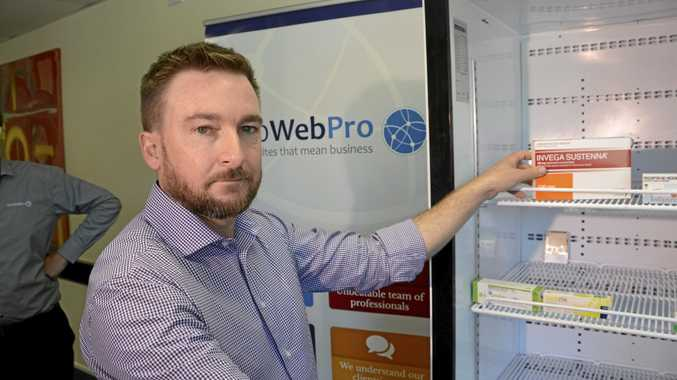 DATA BASE: 1300 Web Pro's Brendan McDonald shows off the new technology called FridgeBrain, which will revolutionise how pharmacies keep vaccines cold.