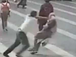 CCTV captures-thug shoving elderly man to the ground