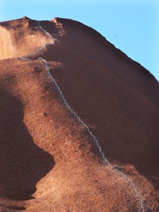 Banning visitors from climbing Uluru is expected to be discussed at meetings today.