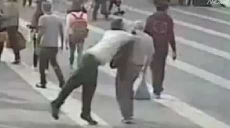 The thug brutally shoves the elderly man to the ground as he passes by him. Picture: Supplied