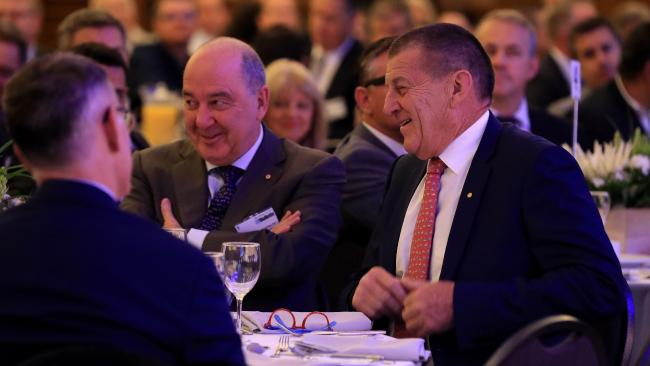 Jeff Kennett (right), former Victorian Premier, arrives late for the Going for Gold Commonwealth Games Symposium at the Marriott Surfers Paradise, sitting next to Legacy Advisory Committee chairman Rob Borbidge. Picture: Adam Head