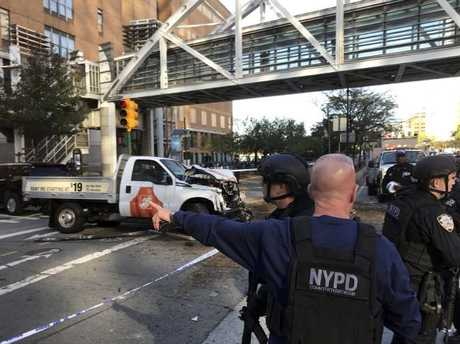 New York City Police Officers respond to report of gunfire along West Street near the pedestrian bridge at Stuyvesant High School in lower Manhattan in New York, Tuesday, Oct. 31, 2017. Picture: Martin Speechley/NYPD via AP