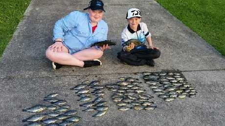 Ella Newton, 12 and Kayos Hapeta-Williams, 7, with a recent catch at Varsity Lakes.