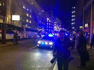 Taxi ploughs into London crowd