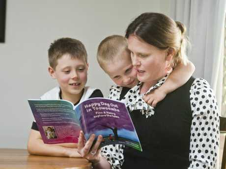 HAPPY READ: ( From left ) Finn, Henry and Megan Carige read the book written by Megan. Thursday, 19th Oct, 2017.