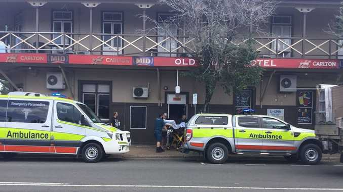 The victim is loaded into an ambulance after a stabbing in Maryborough on Thursday.