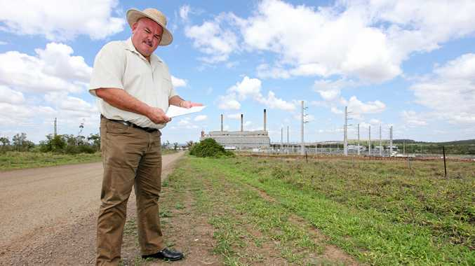 Labor candidate for the seat of Burdekin Mike Brunker outside the Collinsville Power Station that he campaigned to get back on line in the late 1990s.
