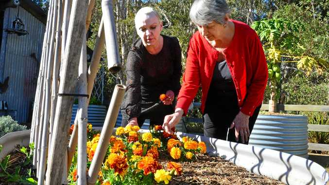 Sandra Gilbert is the manager of NoosaCare, which operates a ground-breaking memory support centre for people with dementia.  Resident Lyn Simon and Sandra have fun at the vege patch in the Rural wing.