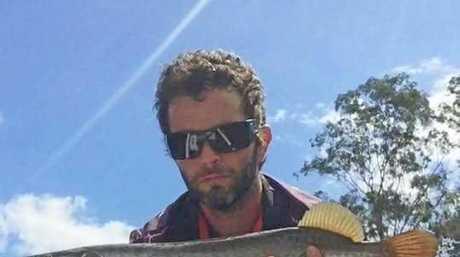 PREDATOR: Jonny Baker at Borumba Dam with a lively saratoga caught last week.