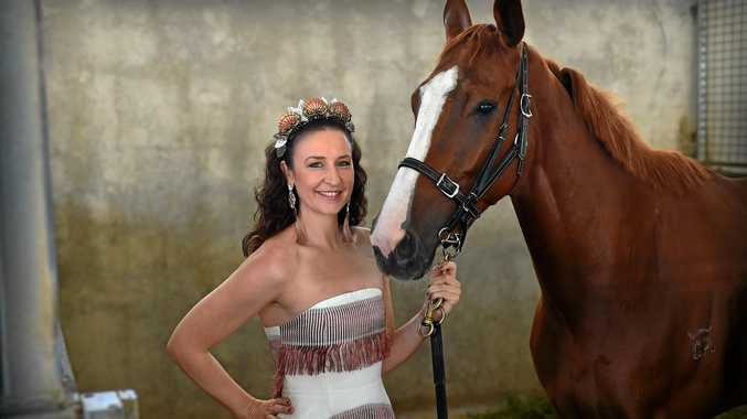 IStyle TV Fashions on the Field coordinator Tam Wrigley meets up with Kendrick Racing-trained horse Light Shows at Corbould Park ahead of Sunshine Coast Turf Club's Melbourne Cup celebrations.