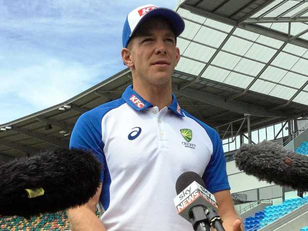 Cricket player Tim Paine talks to the media in Hobart.