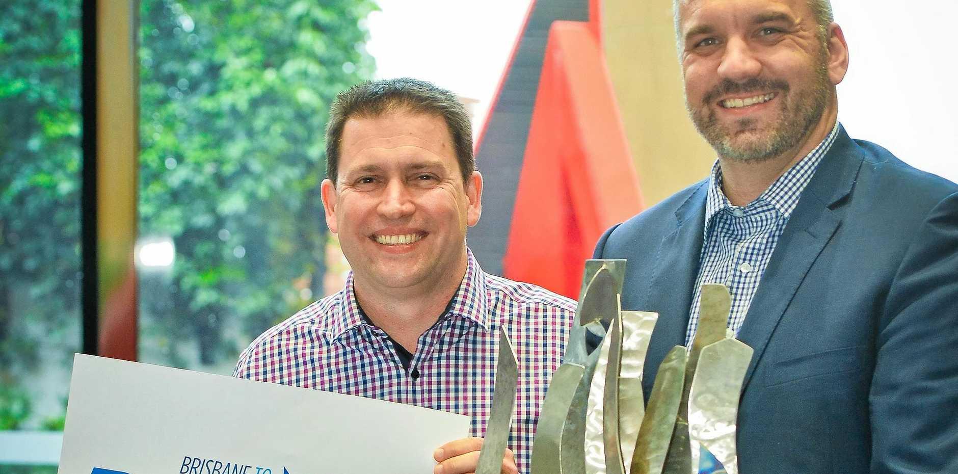 Mayor Matt Burnett and Matthew Bourke from Brisbane City Council with the Brisbane to Gladstone trophy.