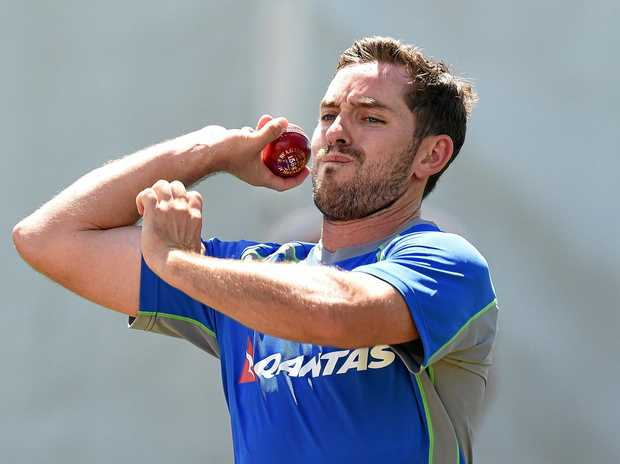 Chadd Sayers prepares to bowl during an Australian cricket team training session.