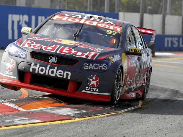 Shane van Gisbergen of the Red Bull Holden Racing Team drives his Holden Commodore VF car through the street circuit at the Gold Coast 600.