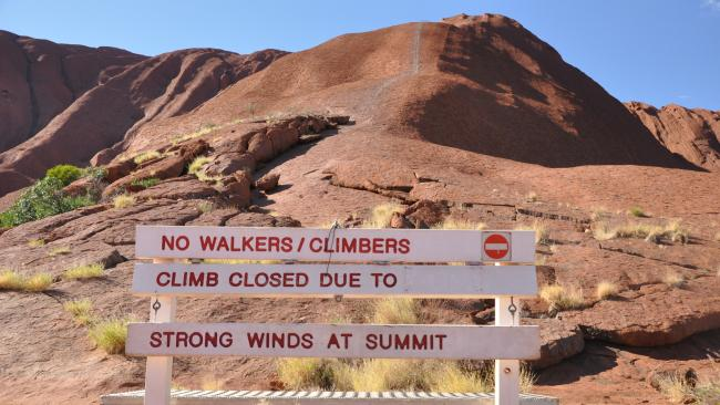 The 'closed' sign at the base of Uluru. Picture: ZACHARY HOPE