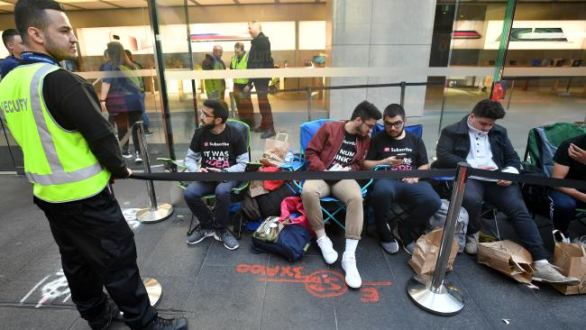 Customers wait in line for the iPhone 8 and 8 Plus at the Apple Store in Sydney. Longer queues are expected for the iPhone X launch on November 3. Picture: AAP Image/Joel Carrett