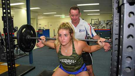 SQUATS: Amy Keen goes through her powerlifting training routine, watched by coach Shaun Housman.