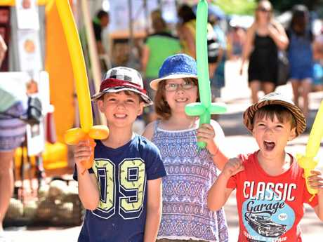 Urangan Pier Park Community Markets - (L) Marcos,6, Ella,7, and Ashley,4, Woods enjoying a visit to the market.