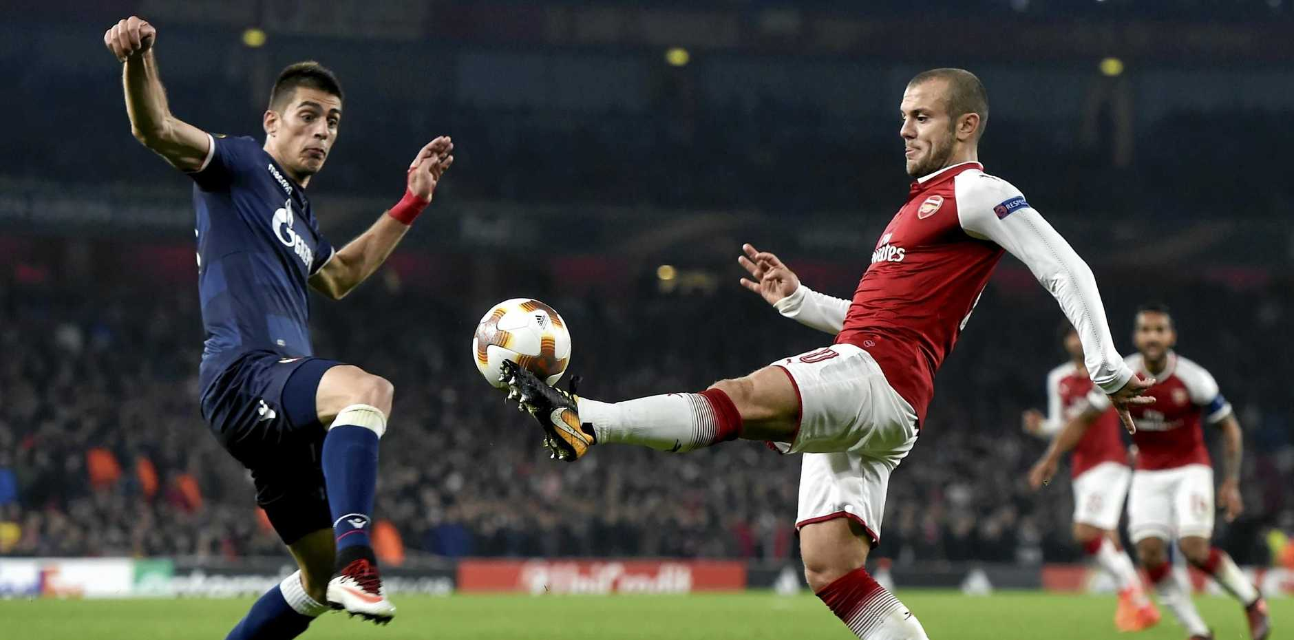 Jack Wilshere (right) of Arsenal and Vujadin Savic of Red Star in action during the UEFA Europa League group stage match.