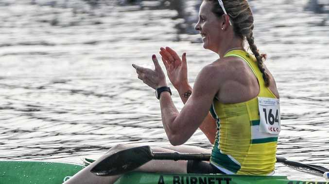 AWARDS CHANCE: Alyce Burnett celebrates after winning the gold medal in the Women's K1 1,000 meters final of the ICF Canoe Sprint World Championships in Racice, Czech Republic.