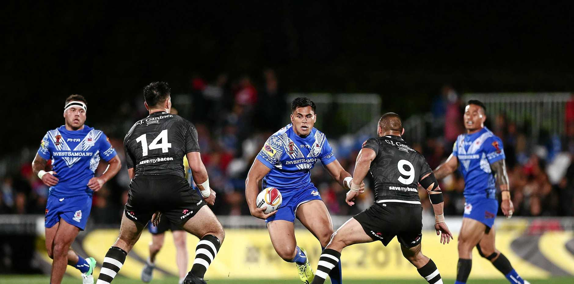 Herman Ese'ese of Samoa makes a run in last weekend's Rugby League World Cup match against New Zealand.