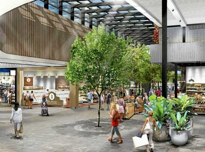 An artist's impression shows the entry to a Coles supermarket at Stockland's proposed Birtinya shopping centre.