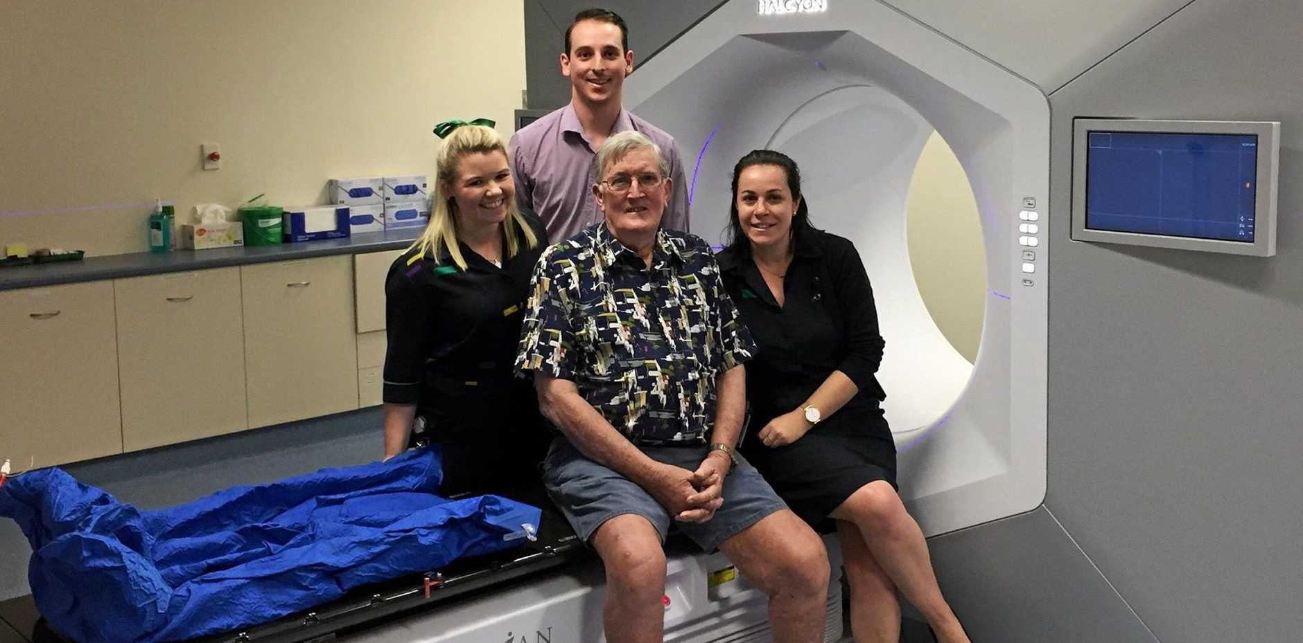 STATE-OF-THE-ART: Dennis McNamara with the team and the Varian Halcyon™ machine at Icon Group's Radiation Oncology Centre.