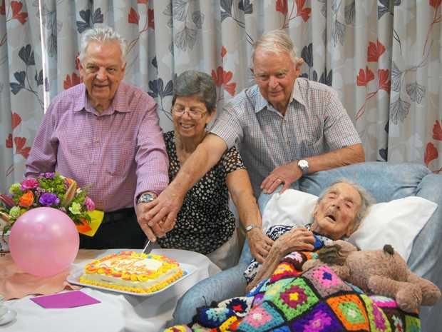 MAJOR MILESTONE: Phyllis Lee celebrates her 110th birthday with her family. Her children David Lee, Marion Weatherhead and Peter Lee cut the birthday cake.