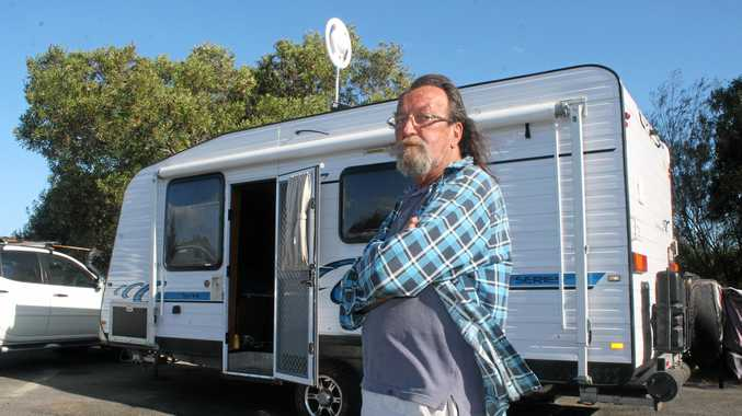 GOTTA MOVE ON: Grey nomad Trevor Gallagher is not happy a No Camping sign has been erected at the highway rest area at the Teven Interchange. But there are plans to construct a service centre at the site.