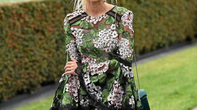 Elyse Knowles poses for a photo on Caulfield Cup Day at Caulfield racecourse in Melbourne, Saturday, October 21, 2017.