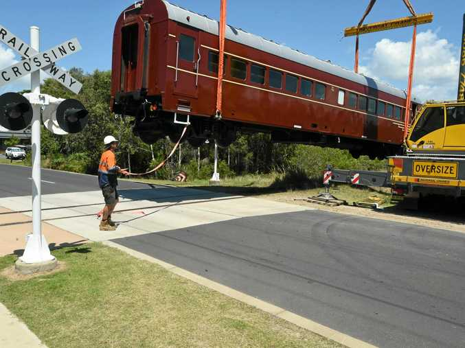 Scores of on-lookers witnessed a world first unfold in Byron Bay as its new solar train was craned in and placed onto the new railway line.