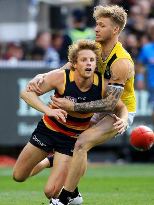 Crows vice-captain Rory Sloane in another contest, this time wrapped up by Richmond's Nathan Broad on grand final day. Picture: Mark Stewart