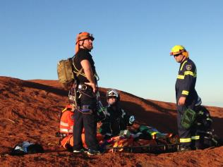 A Taiwanese tourist is rescued from Uluru in 2015.