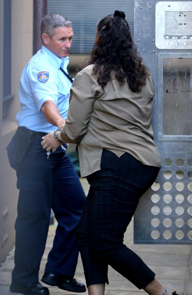 Joseph's mother 'LN' is led into the Supreme Court to face murder charges. Picture: John Grainger.