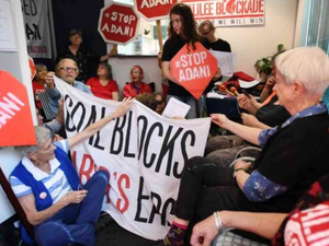 Anti-Adani protesters storm stage during leaders debate
