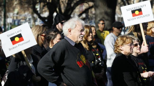 Michael Mansell listening to speakers at a rally during NAIDOC.