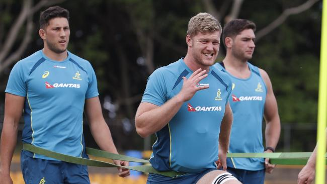 New Wallabies players Matt Philip (2nd left) and Blake Enver stretchy during a training session at Leichhardt Oval in Sydney Monday, October 30, 2017. The Wallabies will face Japan on November 4. (AAP Image/Daniel Munoz) NO ARCHIVING